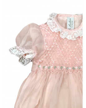 Christening silk romper with smocked bodice, pink detail.