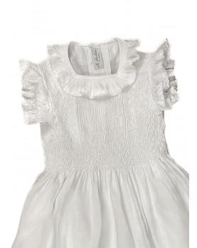 Maria sole abito per bambina con smock in lino bianco. Dettaglio.